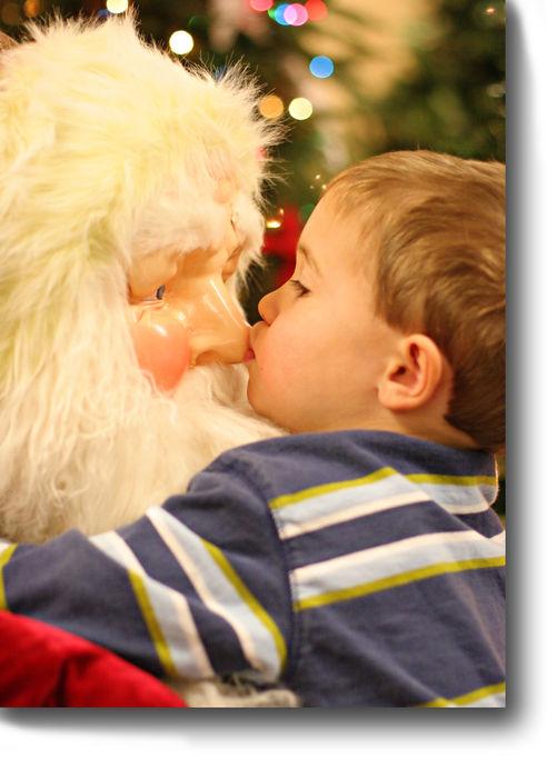 Luke kissing wegmans santa for blog